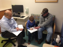 John signing the DFMO consent with the help of Dr. Rawaas and Dad.